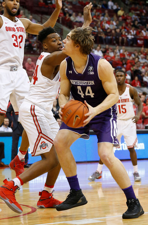 . Northwestern\'s Gavin Skelly, right, looks for an open shot against Ohio State\'s Andre Wesson during the first half of an NCAA college basketball game Sunday, Jan. 22, 2017, in Columbus, Ohio. (AP Photo/Jay LaPrete)