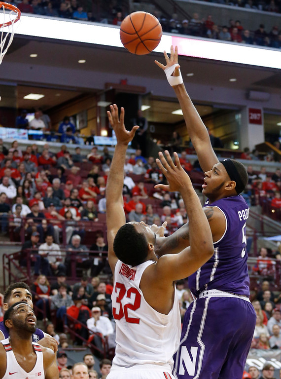 . Northwestern\'s Dererk Pardon, right, shoots over Ohio State\'s Trevor Thompson during the first half of an NCAA college basketball game Sunday, Jan. 22, 2017, in Columbus, Ohio. (AP Photo/Jay LaPrete)