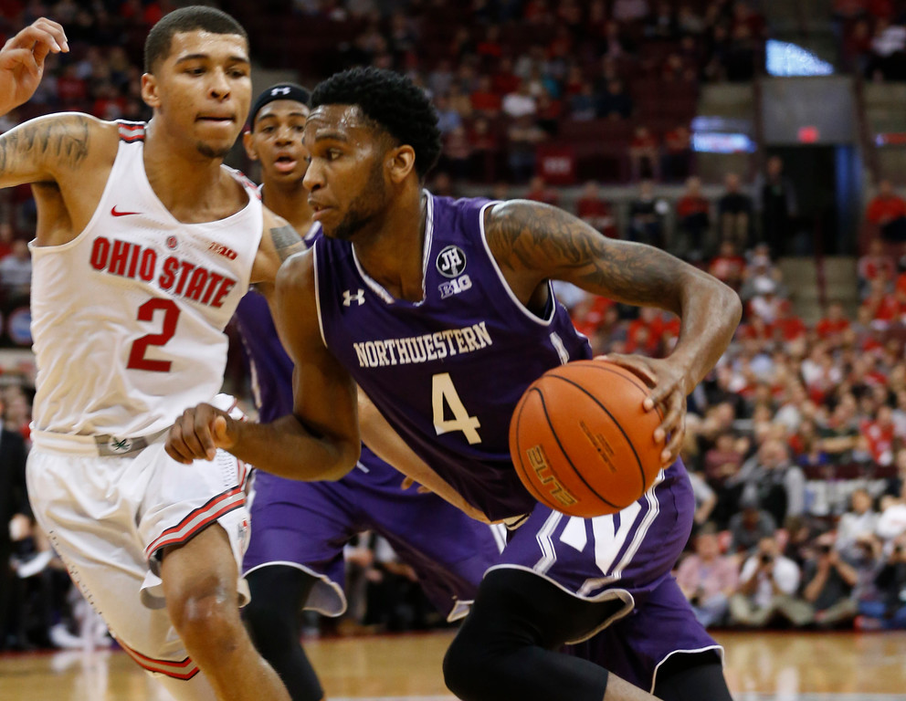 . Northwestern\'s Vic Law, right, drives to the basket against Ohio State\'s Marc Loving during the first half of an NCAA college basketball game Sunday, Jan. 22, 2017, in Columbus, Ohio. (AP Photo/Jay LaPrete)