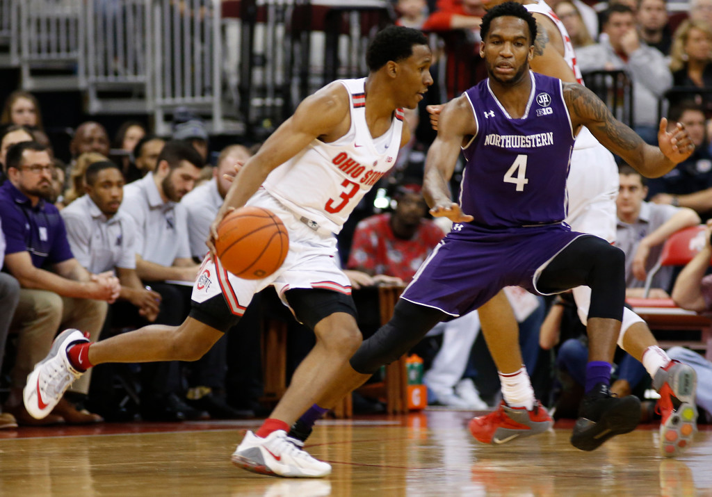 . Ohio State\'s C.J. Jackson, left, tries to dribble past Northwestern\'s Vic Law during the first half of an NCAA college basketball game Sunday, Jan. 22, 2017, in Columbus, Ohio. (AP Photo/Jay LaPrete)