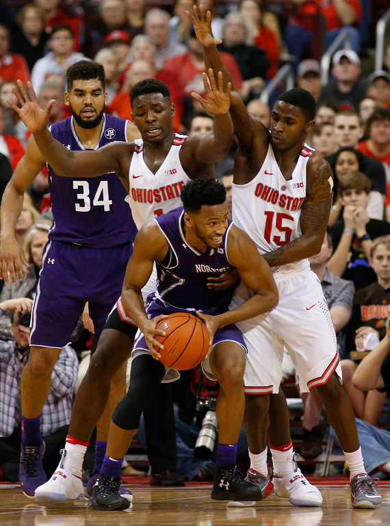 . Ohio State\'s Jai\'Sean Tate, left, and Kam Williams, right, trap Northwestern\'s Isiah Brown during the second half of an NCAA college basketball game Sunday, Jan. 22, 2017, in Columbus, Ohio. Northwestern defeated Ohio State 74-72. (AP Photo/Jay LaPrete)
