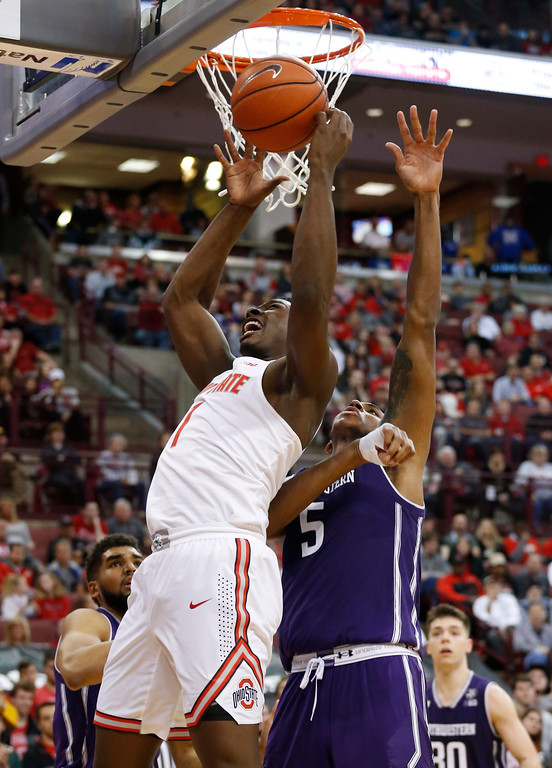 . Ohio State\'s Jai\'Sean Tate, left, shoots in front of Northwestern\'s Dererk Pardon during the second half of an NCAA college basketball game Sunday, Jan. 22, 2017, in Columbus, Ohio. (AP Photo/Jay LaPrete)