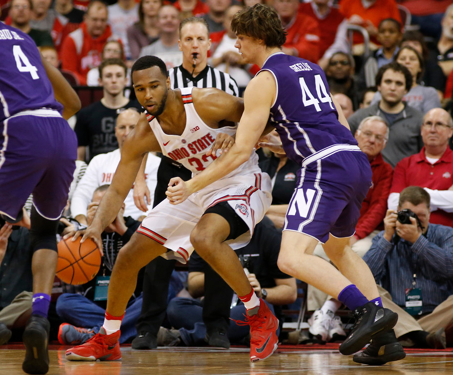 . Ohio State\'s Trevor Thompson, left, posts up against Northwestern\'s Gavin Skelly during the first half of an NCAA college basketball game Sunday, Jan. 22, 2017, in Columbus, Ohio. (AP Photo/Jay LaPrete)
