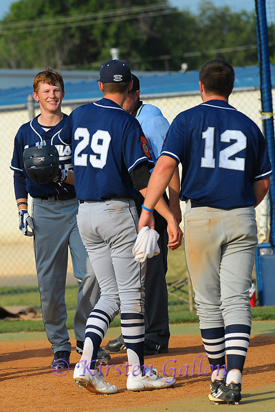 Following his teammate with a home run of his own, Hunter Heath is greeted at home plate by Dalton Viner #29 and Taylor Hawkins #12.