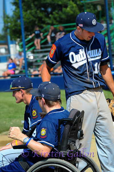 Greg Bruno shakes hands with P.J. Swartz after scoring another run.