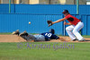 Greg Bruno slides back to first to beat the throw.