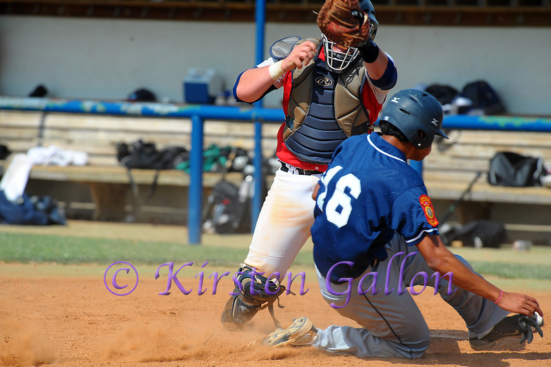 Alex Polston has a close call at the plate.