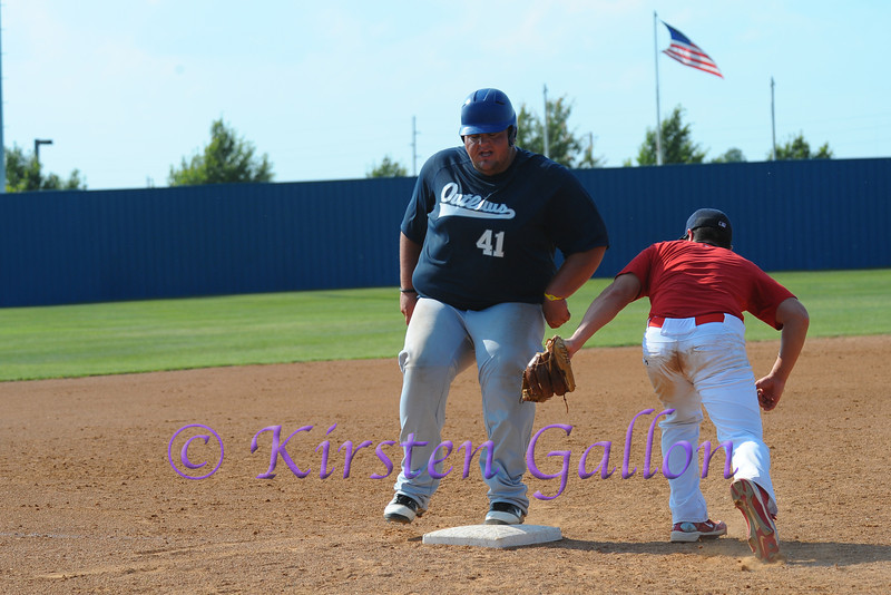 Ty Ash almost makes a third base steal.