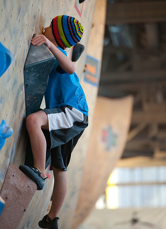 Solomen Fitzgerald is 10 years old and climbs out of Colorado Springs. He joins over 200 of the top climbers in the ABS National Climbing Championships. At the Front Climbing Gym in Ogden on December 10, 2014.