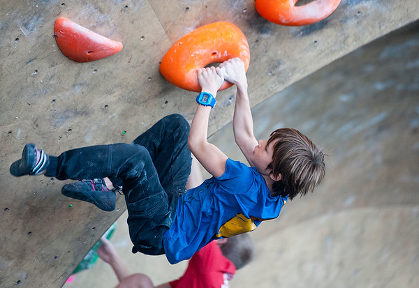 Nine year old Oscar Baudrand competes in the ABS National Climbing Championships. He climbs out of Salt Lake City. At the Front Climbing Gym in Ogden on December 10, 2014