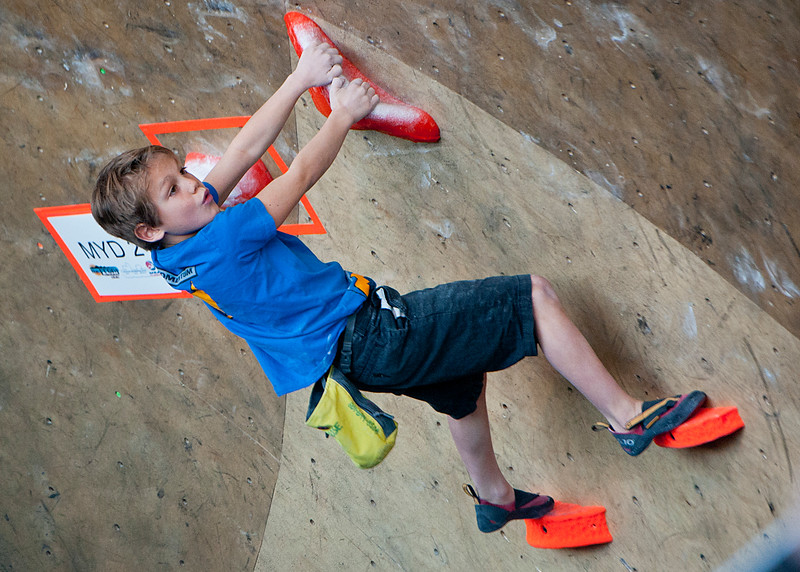 "Eight year old Jackson Delgrosom  also known as ""Goose"" concentrates on his climb. This section is particularly  difficult because the distance between grips. At the Front Climbing Gym in Ogden on December 10, 2014."