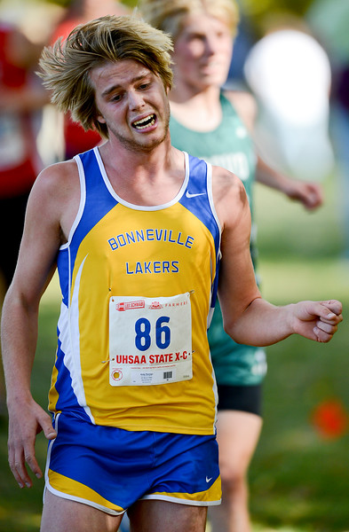 Andy Penman struggles to complete the 4A boy's cross country championships. At Sugarhouse Park in Salt Lake City. On October 23 2013. (Brian Wolfer Special to the Standard-Examiner)