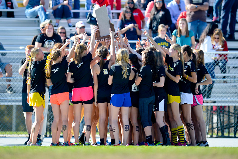 Davis High School's cross county team hoist up a trophy after completing the girls 5a championships. At Sugarhouse Park in Salt Lake City. On October 23 2013. (Brian Wolfer Special to the Standard-Examiner)