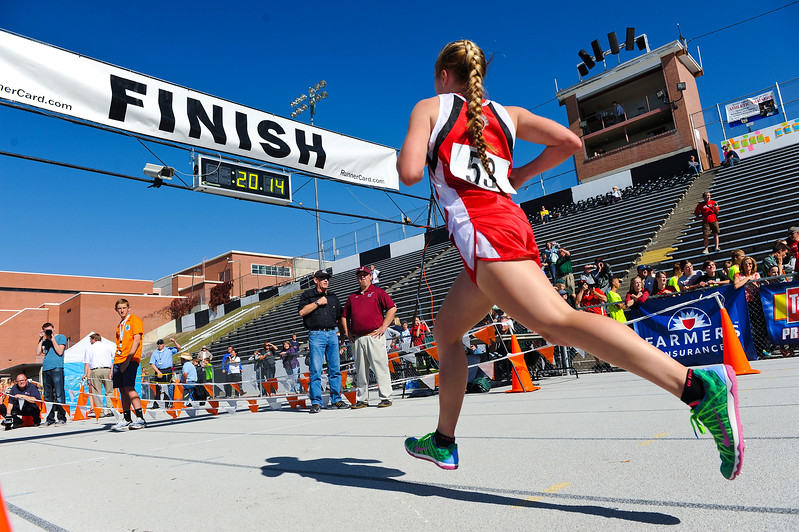 Rachel Hughes from Bear Lake, Finishes strong at the cross country championships. At Sugarhouse Park in Salt Lake City. On October 23 2013. (Brian Wolfer Special to the Standard-Examiner)