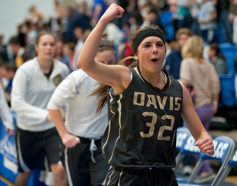 Hannah Snell celebrates Davis High School's victory over Hunter High School. On Monday at Salt Lake Community College on February 16, 2015.