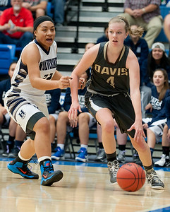Kaylee Morgan # 4 looks for a open team mate to pass to. While Jasmine Soi tries to catch up. At the Girls State Basketball Tournament. At Salt Lake Community College on February 16, 2015.