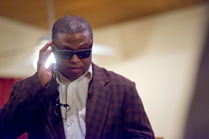 Darrell Gray pretends to be secret service for Michelle Obama at the Embry Methodist Church for the Founders Day of Black History Program. In Ogden, On February 15, 2014. (Brian Wolfer Special to the Standard-Examiner)