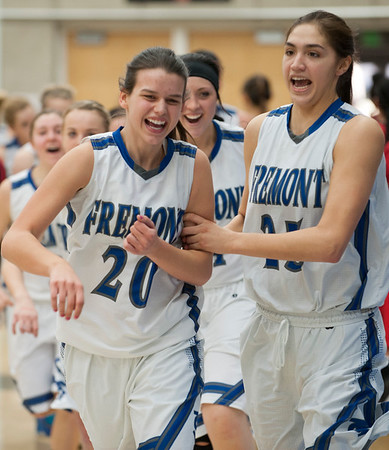 Teammates Tori Sturdevant # 20 and Maryah Tipping #25 celebrate their overwhelming win over West High School. At Salt Lake Community College on February 16, 2015.