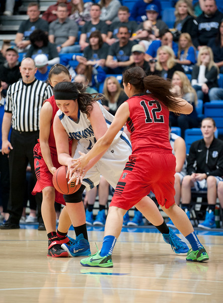 Rylee Thompson #24 tires to get postion over the basketball over West High's Jaylunn Eagle #12. At Salt Lake Community College on February 16, 2015.