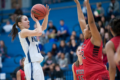 Senior Shelbee Molen #10 shoots the jump shot over West High defender Brianna White #33. During the Girls State Basketball Tournament. At Salt Lake Community College on February 16, 2015.