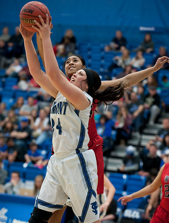 Rylee Thompson #24 wins the position of the rebound over West High School defender.. On Monday at Salt Lake Community College on February 16, 2015.