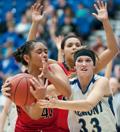Forward Kaycee Anderson # 33 battles for the ball with West High School's Rayna Aiono # 41. At the Girls State Basketball Tournament. At Salt Lake Community College on February 16, 2015.