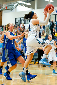 Layton's Maddie Smith #24 beats defender Chelsea Bennett #21 for the up close layup. At Layton High School. On February 11, 2014. (Brian Wolfer Special to the Standard-Examiner)