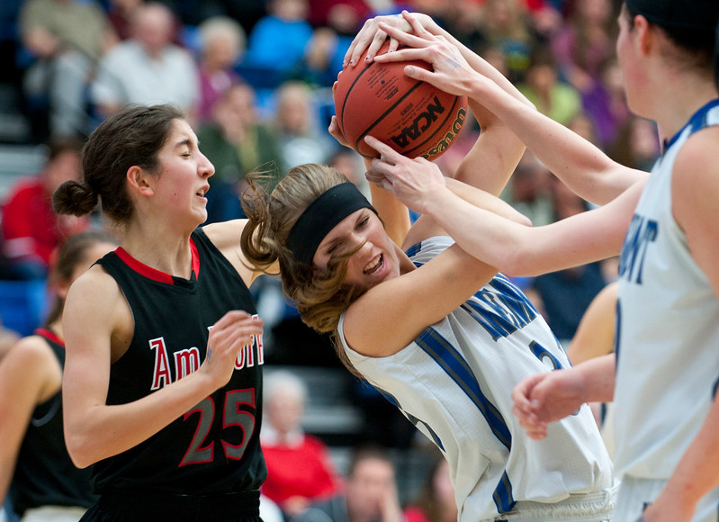 Kaycee Anderson # 33 and Paige Farnsworth #25 battle for possession of the ball at the Girls Basketball State Semifinal. At Salt Lake Community College on February 20, 2015.