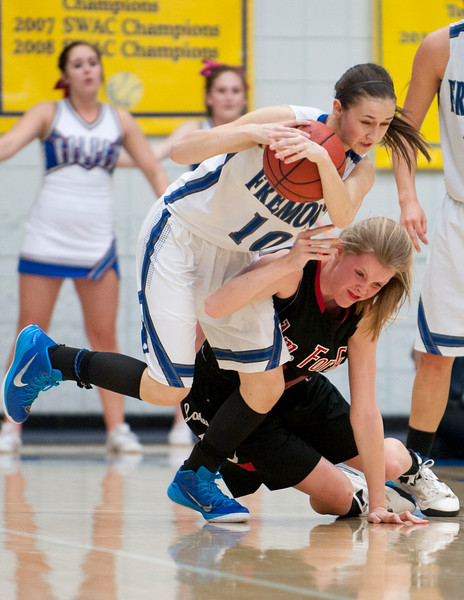 Senior Darbi Ferrell #10 gains possession over American Fork forward Savana Stephenson #34. At Salt Lake Community College on February 20, 2015.