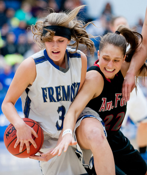 Fremont's Kaycee Anderson # 33 holds on to the ball after it nearly being stolen by guard  Jenna Shepherd #22. During the State Semifinals at Salt Lake Community College on February 20, 2015.