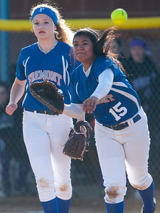 Ran Hadley #15 gathers the ball and throws it to third base as pitcher Kierstyn Ketchell #16 backs her up. In Plane City on March 5, 2015. at Fremont High School on March 5, 2015