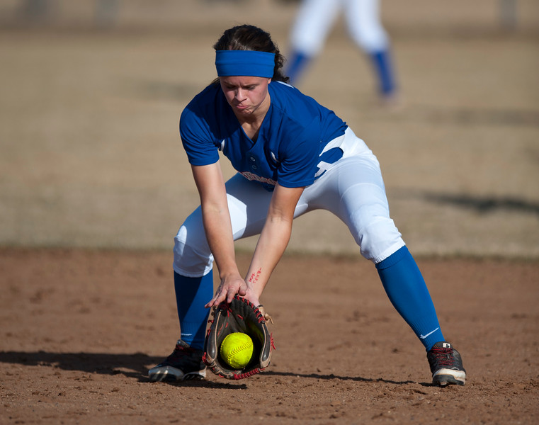 Ryley Ball #9 gets the ground ball and throws it to first base against Box Elder softball team. In Plain City at Fremont High School on March 5, 2015
