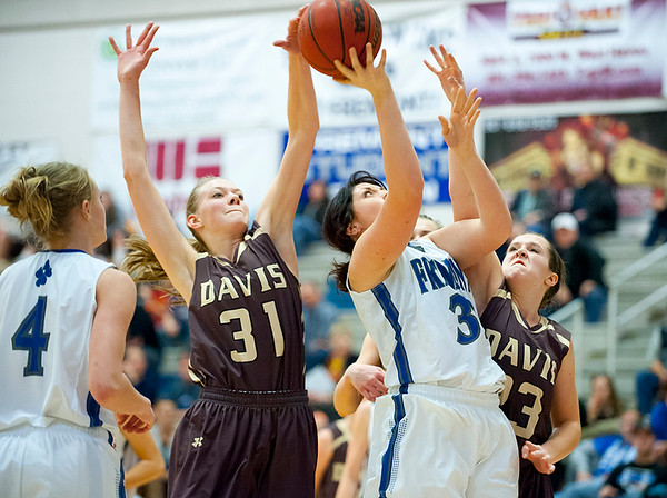 Mckenzie Graves # 3 goes for the up close layup while davis defenders Mckenzie Day and Meaghan David try to steal the ball away. At Fremont High School On January 14  (Brian Wolfer Special to the Standard-Examiner)