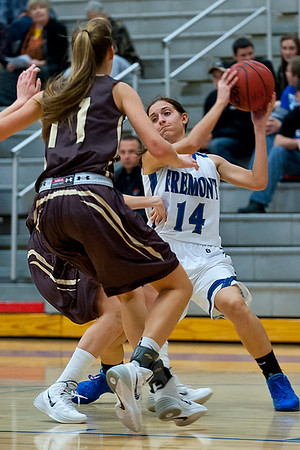 Harley Hansen #14 keeps the ball away from Davis defender Mckinlay Otterson #11. At Fremont High School On January 14  (Brian Wolfer Special to the Standard-Examiner)