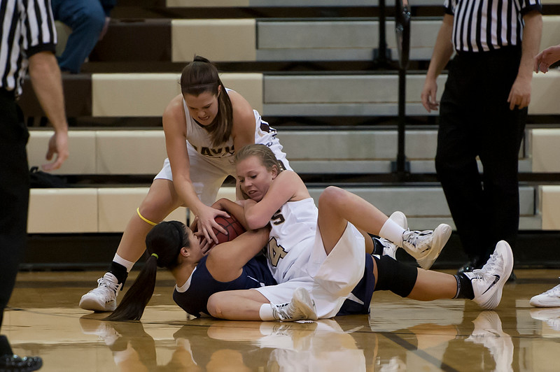 Kayley Neilson #4 tries to rip the ball from the Titans player. At Davis High School in Kaysville. On January 28 2014. (Brian Wolfer Special to the Standard-Examiner)