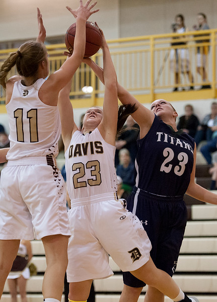 Meaghan David  # 23 and defender Demi Hamblin #23 fight for the ball. At Davis High School in Kaysville. On January 28 2014. (Brian Wolfer Special to the Standard-Examiner)