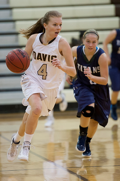 Kayley Neilson #4 drives the ball downcourt during a fast break. defender Courtnee Bearnson #2 tries to catch up and stop the easy score. At Davis High School in Kaysville. On January 28 2014. (Brian Wolfer Special to the Standard-Examiner)