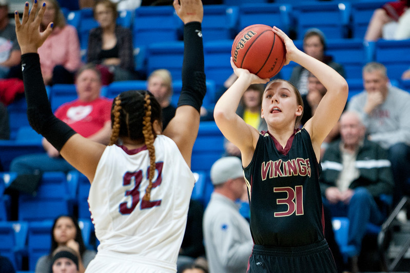 Viewmont Guard Katie Toole #31 takes the three point shot against defensive player Maleini Fa'asou #32