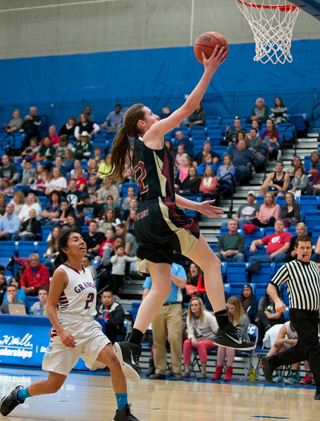 Mercedes Staples #12 beats defender Ailyn Angel # 2 to the basket with the easy layup. At the Girls State Basketball Tournament. At Salt Lake Community College on February 16, 2015.