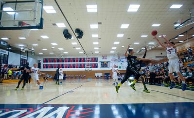 Kearns High School takes on Woods Cross High School in Woods Cross on January 21, 2015.