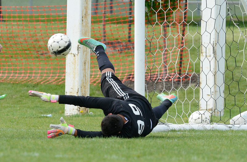 Logan's goalkeeper Andy Arroyo #99 makes a impressive save to keep his team ahead. On Friday at Mt Ogden Park on May 1, 2015.