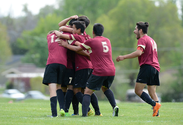 Logan High School boys soccer team celebrities after the first goal of the game.On Friday at Mt Ogden Park on May 1, 2015.