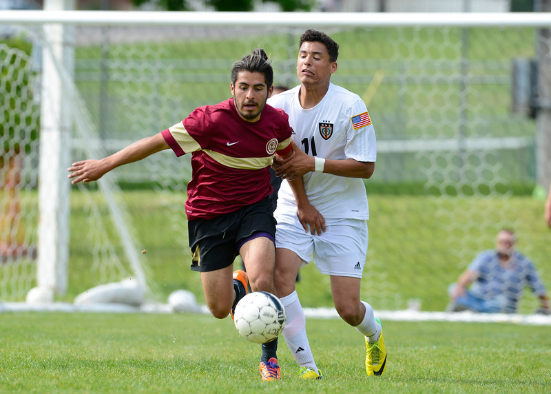 Logan's Manny Sanchez #14 and forward Jaxon Clarke battle for the ball <br /> at Mt Ogden Park on May 1, 2015.