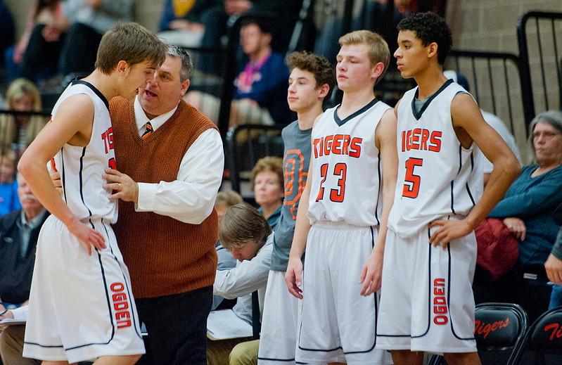 Ogden High School's coach Shawn Queen makes some adjustments with player Cameron Mortensen #12 in the second period. At Ogden High School. On January 7 2015.