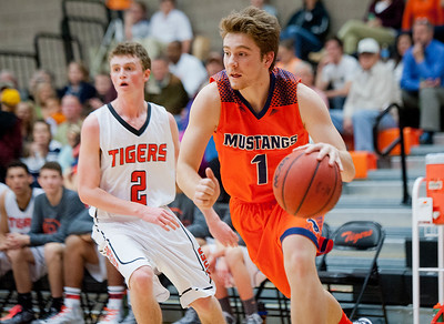 Mountain Crest's Tanner Schwab #1 drives the ball around defender Cale Kwallek #2. At Ogden High School. On Wednesday January 7 2015.