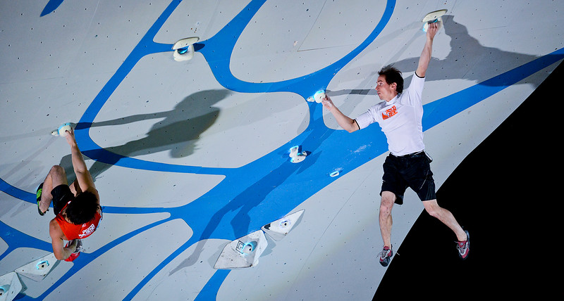 Carlo Traversi (right) holds on by his fingure tips as his competitor Jon Cardwell (right) makes the climb competitive. At the Utah Olympic Park in Park City, on August 2, 2013.(Brian Wolfer Special to the Standard-Examiner)