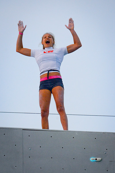 In victorious fashion, Sasha DiGiulian celebrates her win in the women's division, at the Utah Olympic Park in Park CIty. On August 2, 2013.(Brian Wolfer Special to the Standard-Examiner)
