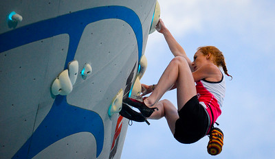 Delaney Miller defies gravity by holding on to the climbing wall with her finger tips, during the Psicobloc Masters Series. held in Park City, on August 2, 2013.(Brian Wolfer Special to the Standard-Examiner)