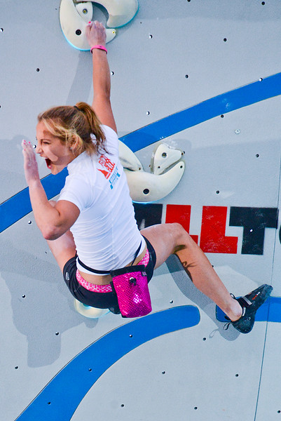 Sasha DiGiulian pumps the crowd up right before she climbs to the summit of the Psicobloc climbing wall. She won the women's division, at the Utah Olympic Park in Park CIty. On August 2, 2013.(Brian Wolfer Special to the Standard-Examiner)