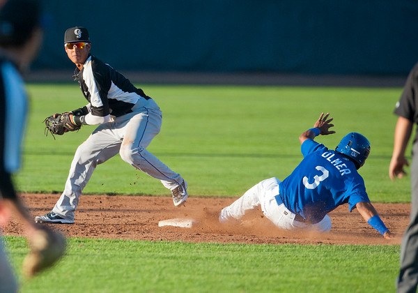 Grand Junction Rockies Second base man Jonathan Pirion # 2 beats Deion Ulmer #3 to the bag to get a out At Lindquist Field in Ogden on July 28 2015.